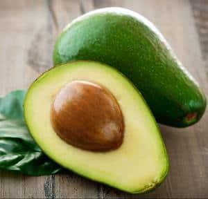 image of a ripe sliced avocado in half