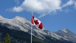 the Canadian flag is swinging in the wind